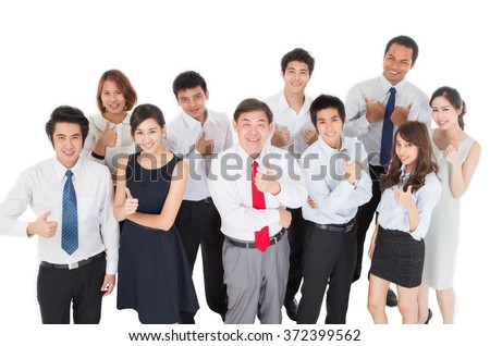 Business team showing thumb - stock photo