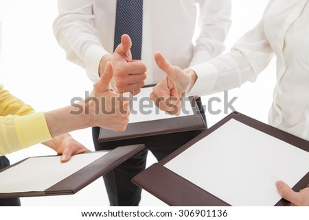 Business team showing  thumbs up, white background