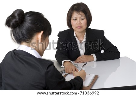 Business team sitting at desk together - stock photo