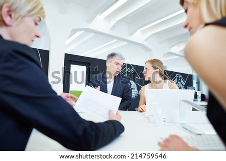Business Team sitting in negotiation meeting in the office - stock photo