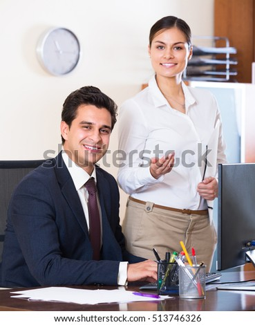 business team smiling and posing in office