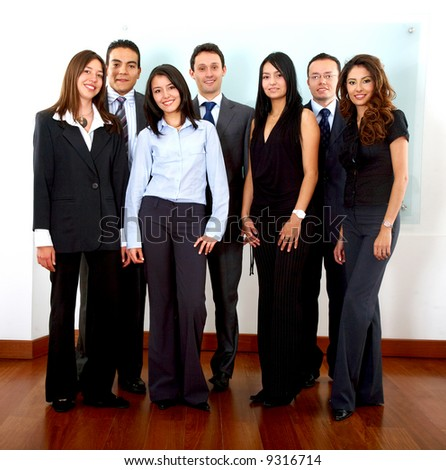 business team standing in an office and smiling - stock photo