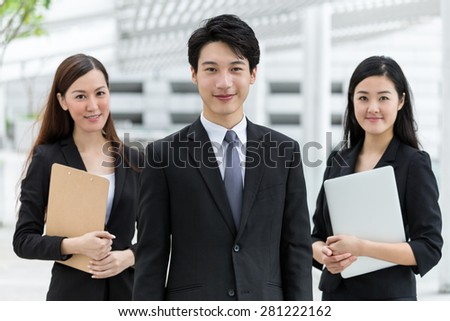 Business team standing together - stock photo