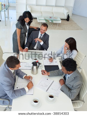 Business team talking about a business project in a meeting - stock photo