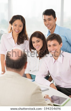 Business team talking to their leader - stock photo