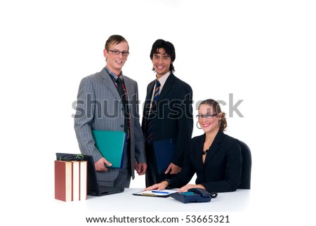 Business team, two young businessmen and female assistant, secretary in the office.  Studio, white background. - stock photo