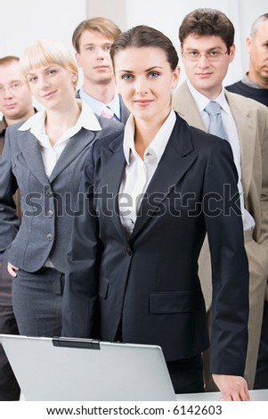 Business team with a businesswoman leading it - stock photo