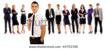 Business team with a relaxed leader with hands in his pockets - stock photo