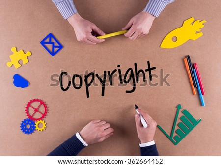 Business Team with a single word Copyright - stock photo