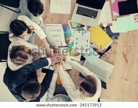 Business team with hands together - teamwork concepts, isolated - stock photo