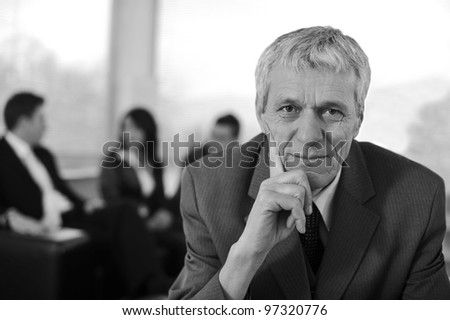 Business team with manager in front - stock photo