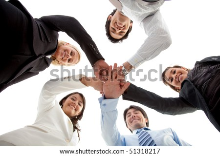business team with their hands together isolated over a white background - stock photo