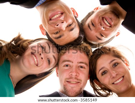 business team with their heads together over a white background