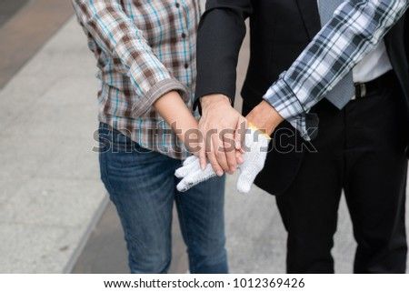 business team work concept : business people hold hand together ,professional agreement partnership community ,selective focus