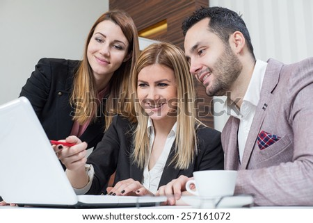 Business team working at office on lap top, successful concept at work. - stock photo