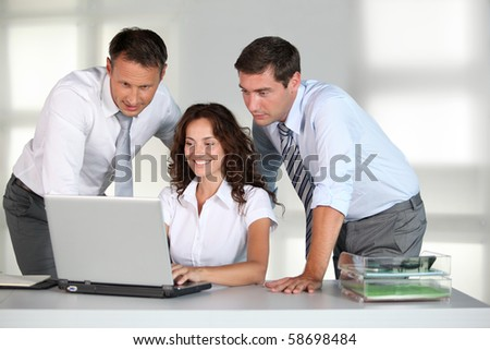 Business team working in the office - stock photo