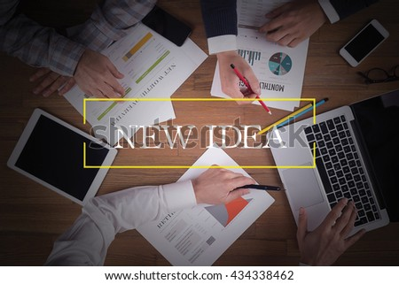 BUSINESS TEAM WORKING OFFICE  New Idea TEAMWORK BRAINSTORMING CONCEPT - stock photo