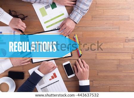 BUSINESS TEAM WORKING OFFICE REGULATIONS DESK CONCEPT - stock photo