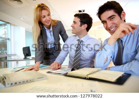 Business team working on sales results - stock photo