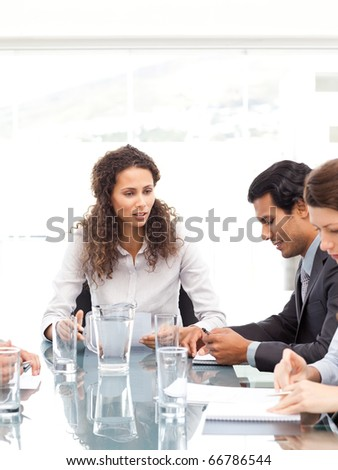 Business team working together around a table during a meeting - stock photo