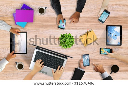 Business team working together,hands using smart phone. desk from above - stock photo