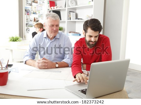 Business team working together in small architect studio. - stock photo