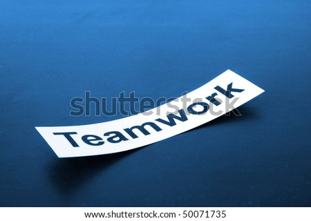 business teamwork concept shown by sheet paper with a word