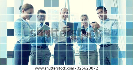 business, teamwork, people and technology concept - business team with tablet pc and smartphones meeting in office over blue squared grid background - stock photo