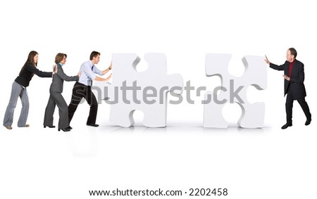 business teamwork - puzzle pieces made in 3d over white - stock photo
