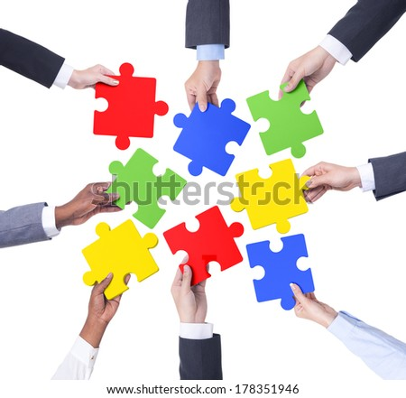 Business Teamwork with Jigsaw Puzzle - stock photo