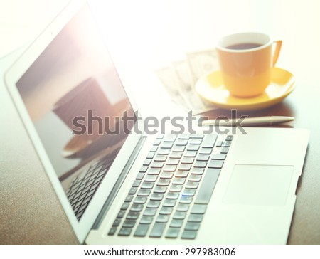 Business Technologies. Workplace with open laptop on modern wooden desk. - stock photo