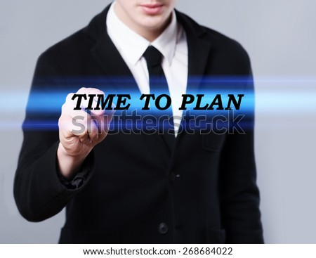 business, technology and internet concept - businessman is writing time to plan text - stock photo