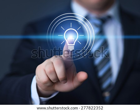 business, technology and internet concept - businessman pressing button with bulb on virtual screens