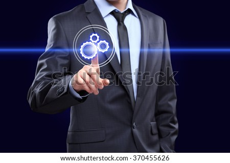 business, technology and internet concept - businessman pressing button with mechanism icon on virtual screens - stock photo