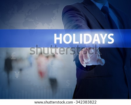 business, technology and internet concept - businessman pressing holidays button on virtual screens - stock photo