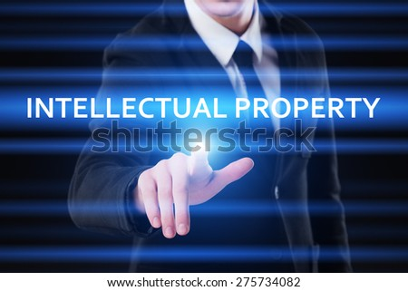 business, technology and internet concept - businessman pressing intellectual property on virtual screens - stock photo