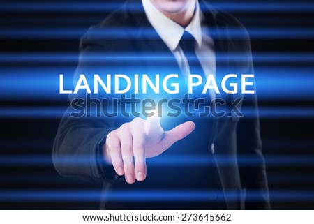 business, technology and internet concept - businessman pressing landing page button on virtual screens - stock photo