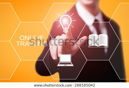 business, technology and internet concept - businessman pressing online training button on virtual screens - stock photo
