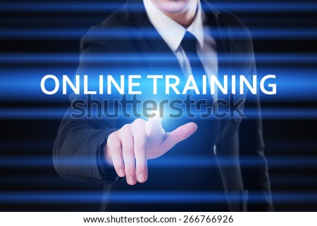 business, technology and internet concept - businessman pressing online training on virtual screens - stock photo