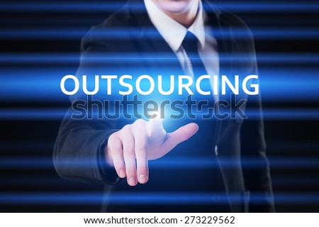 business, technology and internet concept - businessman pressing outsourcing on virtual screens - stock photo
