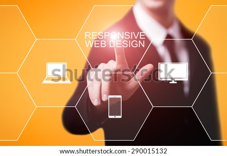 business, technology and internet concept - businessman pressing responsive web design button on virtual screens - stock photo