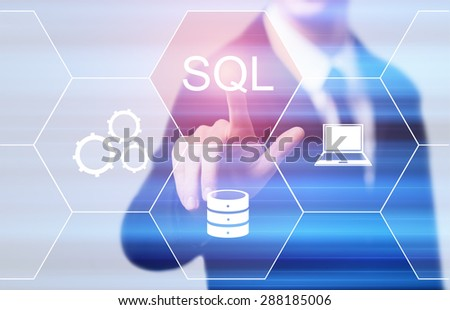business, technology and internet concept - businessman pressing sql button on virtual screens - stock photo