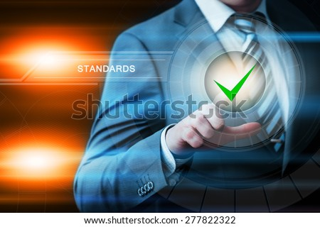 business, technology and internet concept - businessman pressing standards button on virtual screens