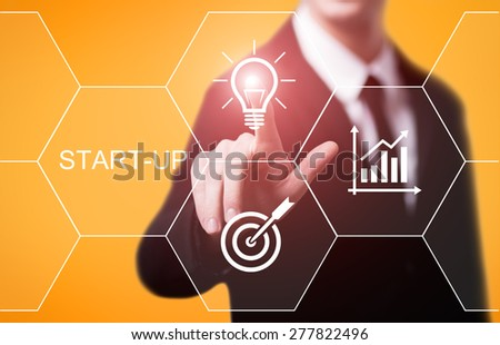 business, technology and internet concept - businessman pressing start-up button on virtual screens - stock photo