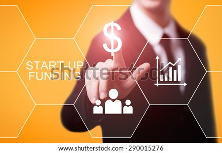 business, technology and internet concept - businessman pressing start-up funding button on virtual screens - stock photo