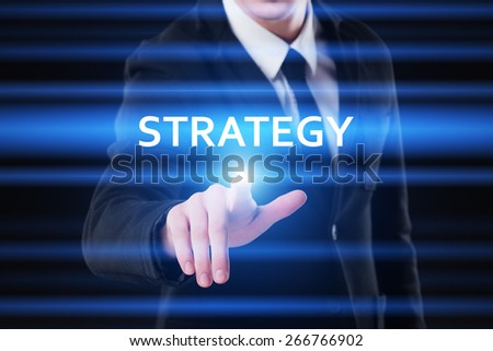business, technology and internet concept - businessman pressing strategy on virtual screens - stock photo