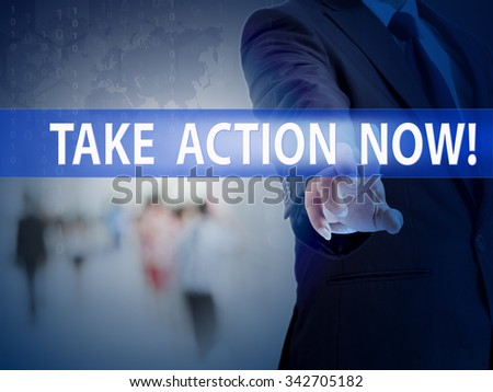 business, technology and internet concept - businessman pressing take action now! button on virtual screens - stock photo