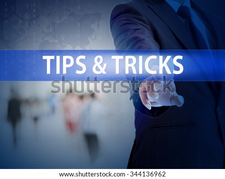 business, technology and internet concept - businessman pressing tips & tricks button on virtual screens - stock photo