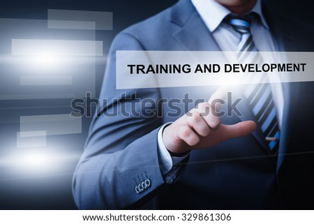 business, technology and internet  concept - businessman pressing training and development button on virtual screens
