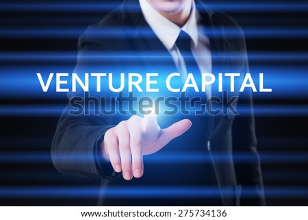 business, technology and internet concept - businessman pressing venture capital on virtual screens - stock photo